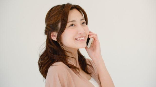 女性と買取交渉の電話イメージ画像